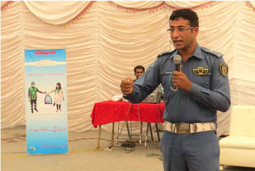 Sub Inspector Moazzam Ali from City Traffic Police Lahore is delivering lecture during drivers' training workshop.